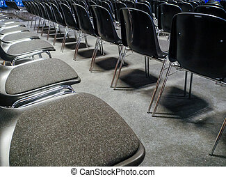 Many empty chairs in conference room