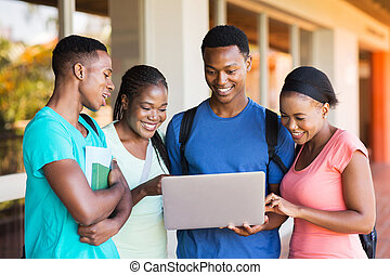 group of african university students using laptop - group of...