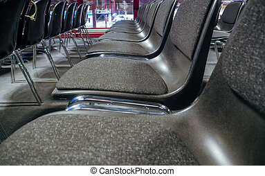 Many empty chairs in conference room - Many empty chairs in...