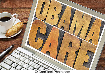 obamacare typography on laptop screen - obamacare typography...