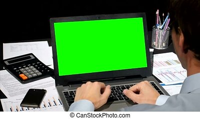 Business people working on his laptop with copy space on a green Screen