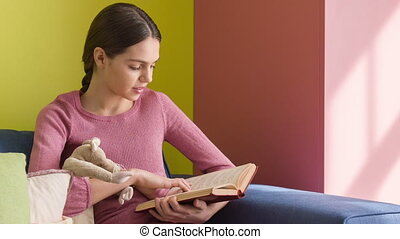 cool brunette girl with pigtail - cute girl reading a book...