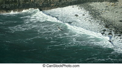 Wave breaking against cliff - Cliffs of Moher in County...