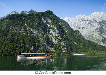 Boat and Alps - Sightseeing boat on the Kings lake in...