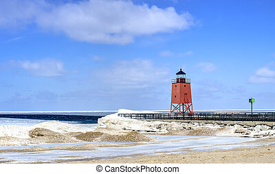 Great Lakes Lighthouse - Snow gives way to sand as spring...