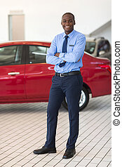 african vehicle salesman with arms crossed
