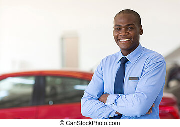 african american car sales consultant with arms folded -...