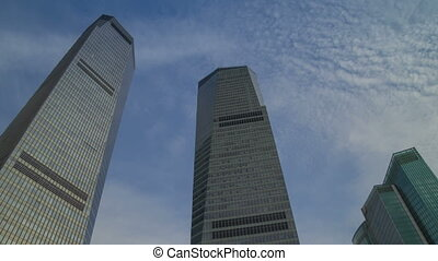 Sky reflection on skyscraper timelapse - Pudong district in...