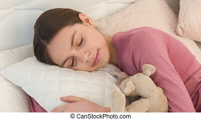 cool brunette girl with pigtail - sleeping beauty. the...