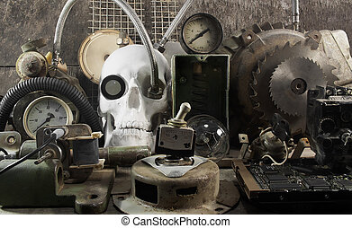 Mechanical skull and parts. - White human skull with...