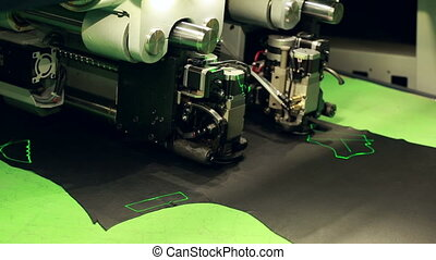 Close-up of automatic machine for cutting leather