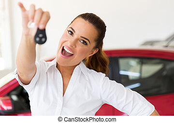 woman holding new car key - excited woman holding new car...