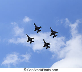 f16 falcon fighter jet flying on blue sky background
