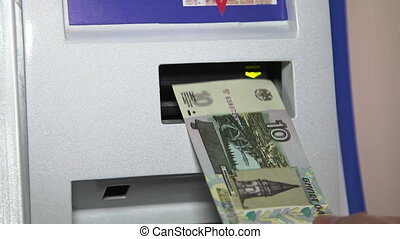 Human hand push money to ATM cash in