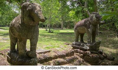 Elefants in Angkor temple slider timelapse - Angkor temples...