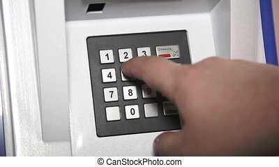 Human hand enter pin code on ATM - Cash mashine in Russia