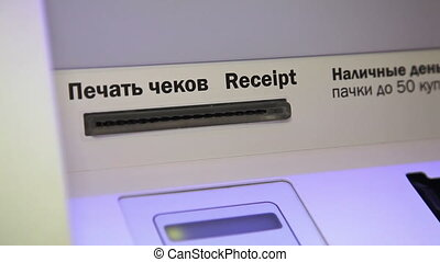 Human hand take receipt from ATM - Cash mashine in Russia