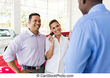 woman receiving a new car from her husband - happy woman...