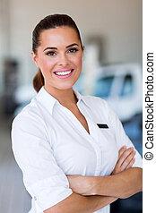 saleswoman standing at car dealership - beautiful saleswoman...