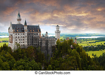 Castle Neuschwanstein at sunset with dramtic sky