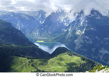 From the Alpine peaks - View at Alps and alpine lake from...