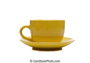 A yellow cup and saucer on white