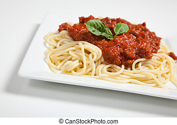 Plate of spaghetti on white