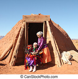 2 Navajo Women Outside Their Traditional Hogan Hut