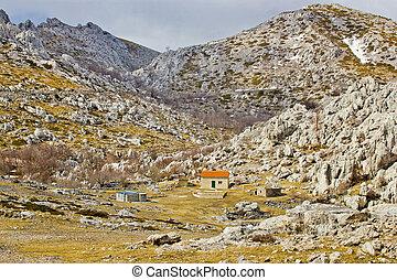 Velebit stone desert and mountain shelter view
