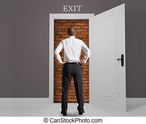 Obstructed exit - Businessman in front of an exit hampered