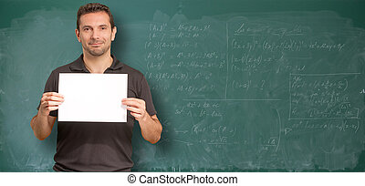 Maths class and message - Man by a blackboard with math...