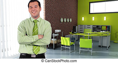 Businessman and green office - Business man standing in an...