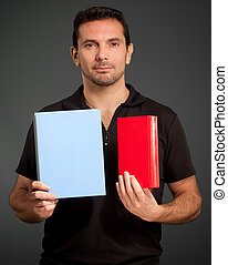 Man presenting two objects - Portrait of a man presenting...