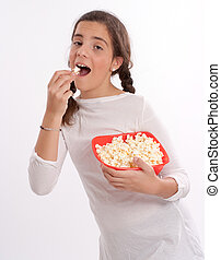 Girl eating popcorn