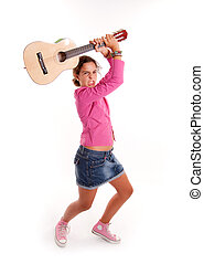 Hard rock child - Young girl banging her guitar in an...