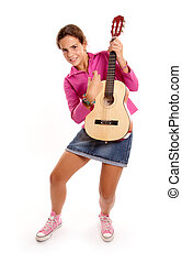 Young rock star - Young girl playing the guitar against a...