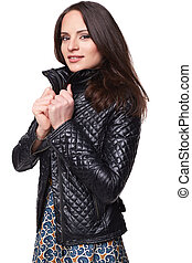 Smiling nice girl in dress with leather jacket. Isolated on white
