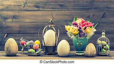 Retro style still life with tulip flowers and easter eggs...
