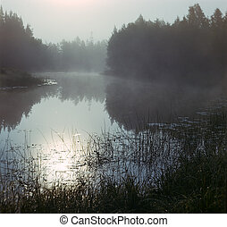 Fog on the silent river in the early morning