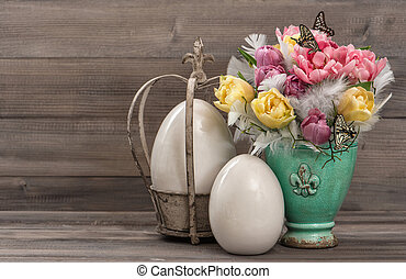 Pastel colored tulip flowers with vintage easter eggs...
