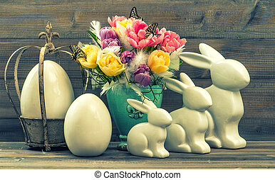 Vintage decoration with tulip flowers, easter eggs and...