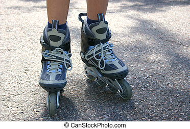 Rollerskates - Young teenage girl wearing gray and blue...