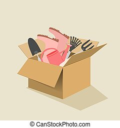 Box filled with garden tool - Open brown cardboard box...