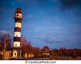 Ocean sunrise with lighthouse in Riga gulf, Baltic sea