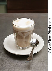 Latte - Cafe Latte Coffee on a Saucer with Teaspoon