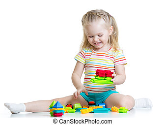 little girl playing block toys