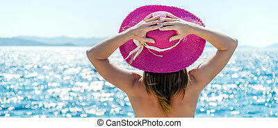 Woman at the sea - Beautiful woman with hat at the beach