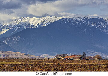 Piatra Craiului mountains - Spring rural landscape with...