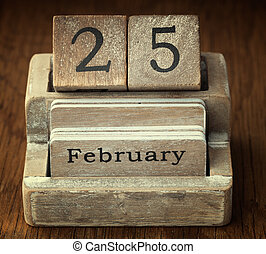 A very old wooden vintage calendar showing the date 25th...