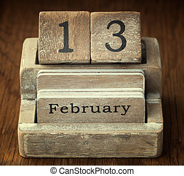 A very old wooden vintage calendar showing the date 13th...